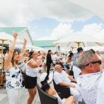 Guests celebrate watching horse racing at the Trackside Clubhouse