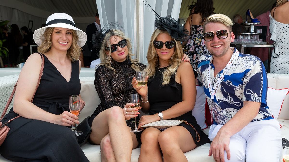 Four guests enjoying an outdoor event at Woodbine Racetrack